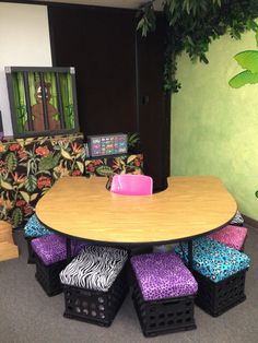 Crate seats with cheetah and zebra print material. Teacher Table and listening center) Sunday School Classroom, Classroom Setting, Classroom Setup, Classroom Design, Kindergarten Classroom, Future Classroom, Classroom Organization, Toddler Classroom, Organizing