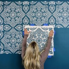 Bright and bold feature wall in our warehouse using Alhambra Tile Stencil #diy #accentwall #painting #homedecor #design