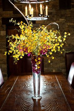 Tall yellow orchid centerpieces by Signature Bloom | click on signaturebloom.com to see more | Chyna Darner Photography | Clos LaChance Winery #weddingcenterpieces #receptionflowers #floraldesigner #florist #sanmartin #ca