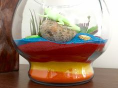 sand art terrarium project with colored decorative sand. An easy to make DIY Terrarium with ideas to add plants, creatures and gems to make a fantastic terrarium. Kids would love this in their bedroom.