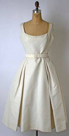 A clean and simple cotton dinner dress from Dior's Spring-Summer 1957 collection.