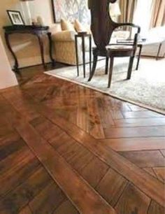 wood floors in kitchen cart with butcher block top 47 best floor transition ideas make your way from one area to the herringbone meet straight boards is at wall which helps define
