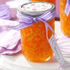 """Zucchini Peach Jelly Recipe -I like to use this jelly as a condiment. It's always a conversation piece—everyone wonders about the """"green"""" ingredient! This beautiful jelly is so easy to make and I often use it as a gift-giving item for the holidays. —Ruth Glick, Dalton, Ohio"""