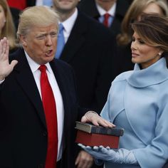 Donald Trump takes the oath of office as his wife Melania holds a bible during his inauguration as the 45th president of the United States on the West front of the U.S. Capitol in Washington, U.S., Jan. 20, 2017.