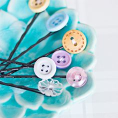 Sew the button on to the bobby pin, add some super glue to provide extra stability and voilá – new, pretty hair pins! (in English and Swedish) #craftgawker