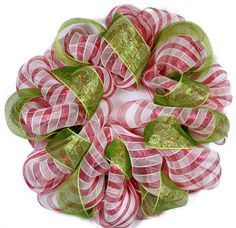 "Candy Cane Wreath with Ribbon Accent:   Add in a accent ribbon to create a different look.  Lime green ribbon adds a modern twist to the traditional color scheme of red and white candy cane stripes.  We added in 4"" wide deco mesh ribbon in metallic moss/lime."
