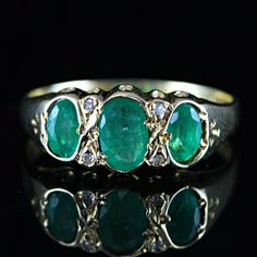 Emerald Gemstone and Diamond engagement ring cast in 9ct. gold