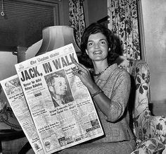 Jackie reads the newspaper headline of her husband's nomination. She did not attend the convention, because she was pregnant. She had attended the 1956 convention, when JFK was considered for Vice-President. She was pregnant then, and lost the baby.