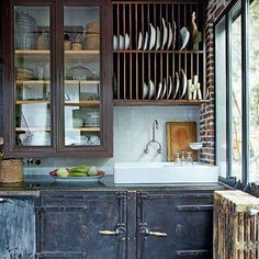 small recycled kitchen. A dish rack over sink makes a lot of sense. Those latching doors would make tiny house travel easier too  http://www.marieclairemaison.com
