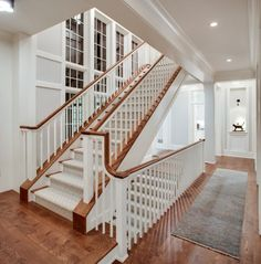 Interesting and beautiful placement of stairs. Not sure if this would save space on main floor for other rooms.