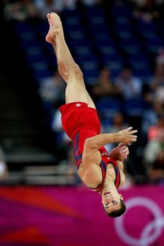 Team USA's Jake Dalton competes on the floor exercise during men's gymnastics event finals at the London Olympics.