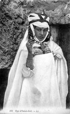 Africa | Ouled Nail woman.  Algeria.  Dated 1917. || Vintage postcard; publisher L.L.  No.145.