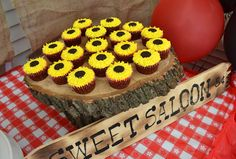 Country western party food - sunflower cupcakes *center of mini cupcakes were made of mini oreos...LOVE!