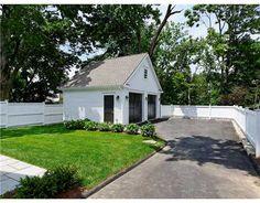 detached garage, paint doors the same color as front door of house. And add side door into yard.
