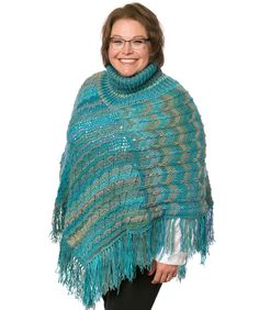 http://www.redheart.com/free-patterns/marlys-turtle-neck-perfect-poncho