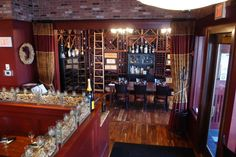 A view of our private Wine Room. A great place to enjoy dinner surrounded by friends, family, and hundreds of bottles of wine! Book your next private party here!    http://tastingswinebarandbistro.com/info/private_dining.php