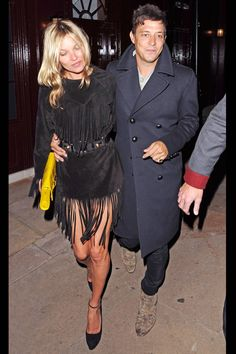 kate moss pulling off the fringe boho mini and lady like pump look out and about with her rockstar husband