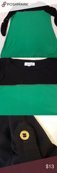 """Calvin Klein Women's Zipper Colorblock Top Calvin Klein Women's Zipper Colorblock Top.  Kelly Green and black.  Medium.  27"""" long. 19.5"""" bust or chest area. 23"""" hip.  Roll up button sleeves.  Good condition. Last picture is the same shirt just in white. Calvin Klein Tops Blouses"""