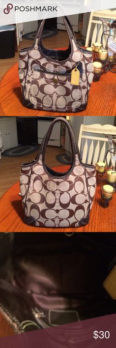 Coach handbag Brown and tan loved medium size coach handbag. 14x 9 x 4 inch. Comes with its tags. Used yet it has a full lifetime left. I loved carrying this bag.  Has some wear. Coach Bags Totes