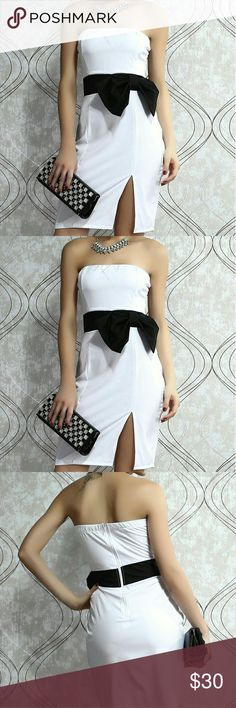 White Strapless Dress Jaw-dropping glamour is the name of the game when you step out in this Stunning Side up Strapless White Dress. The stretchy woven material provides the perfect body fit from strapless, princess seamed bodice to knee-length hem with a sexy side slit. An over sized eye-popping bow sits to the side of a banded waist for avant garde allure. Comes with a hidden back zipper and the front of bodice is lined. A-30 Dresses Midi