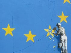 A recently painted mural by British graffiti artist Banksy, depicting a workman chipping away at one of the stars on a European Union (EU) themed flag, is pictured in Dover, south east England. Courtesy of Banksy, via Instagram.