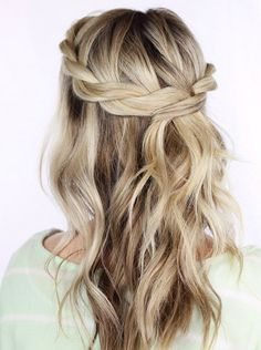 Crown braid medium hair.  Wavy just below the shoulder hair paired with a simple twisted crown braid.