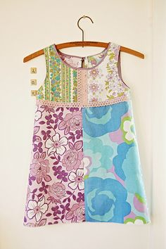 This makes we want to start sewing little girl dresses again.  Oh how I loved making dresses for Cora.