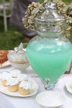 Mint colored lemonade. Lemonade + a little bit of blue koolaid(could do this with another color koolaid too to match color theme of the wedding)