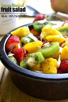 """This BOOZY TROPICAL FRUIT SALAD is the perfect addition to your spring or summer menu! Loaded with fresh tropical fruit and swimming in a boozy coconut-lime """"dressing"""", it's sure to become your favorite new way to eat fruit! Fruit Salad Recipes, Chicken Salad Recipes, Fruit Salads, Jello Salads, Salad Bar, Soup And Salad, Cobb Salad, Side Dishes Easy, Side Dish Recipes"""