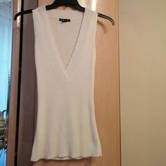 White deep v neck tunic Nwot. Never worn. coolwear  Tops Tunics