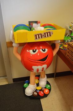 I got my hands on an actual M&M stand up! Perfect for holding the plates & utensils!