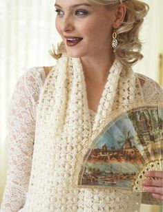 Channel your favorite classic movie star with this Vintage Lace Popcorn Shawl. Inspired by the timeless looks of old Hollywood glamour, this particular piece is an easy crochet pattern to work up with lovely lace yarn.