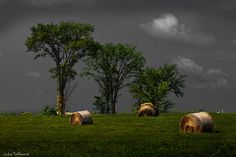 awesome...dark clouds and the sun shining on the hay bales