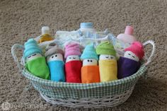 Want to make a cute and inexpensive homemade baby shower gift? Follow these easy instructions on how to make diaper babies! Easy and cute baby shower gift!
