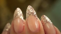 Almond shaped French manicure with gold glittery tip.