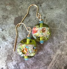 Not rocks, but such lovely glass I couldn't resist. A kaliedescope of spring blooms dangling from your ears. Accented with tiny blue Czech glass crystals, gold