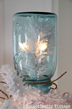 Christmas House Tours - step inside this 100 year old home filled with tons of fabulous decorating ideas like this mason jar tree topper!  eclecticallyvintage.com