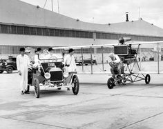 """As part of the World's Fair of Aviation, held in 1946 at Offutt Air Force Base, a 1912 airplane and a 1912 automobile offered a stark contrast with the """"sleek, 600-mile-per-hour aircraft"""" on display at the fair. When the two 1912 models raced, the 60-mile-per-hour plane easily won. It was flown by Billy Parker, head of the Phillips Petroleum aviation department. This photo ran July 20, 1946. THE WORLD-HERALD"""