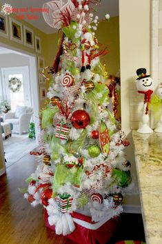 whimsical christmas tree - LOVE the colors and the topper too!