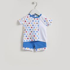 A lovely Bermuda short set for baby boy from Kissy Kissy. Made from 100% Peruvian pima cotton for softness and comfort. This outfit has cute multi-coloured polka dots on the top and the trim of the shorts. Top secured with popper fastening. Elasticated trouser waist for maximum comfort. A lovely outfit for everyday wear or a …