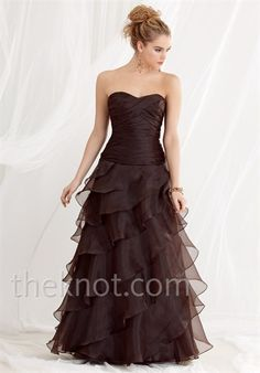 Dress features pleats and flounced skirt. Also available in junior sizes.