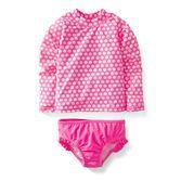 Protect her from sun and sand with this long-sleeve UPF  50 neon polka dot rash guard set.  Ruffled bikini bottoms make it oh-so girly!