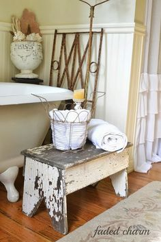 Chippy bench in the bathroom / A beautifully reclaimed bathroom tour by Faded Charm, featured on www.ilovethatjunk...