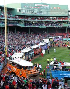 Duck boats line the field prior to the start of the Boston Red Sox World Series Champions rolling duck boat parade at Fenway Park on Saturday, Nov. 2, 2013.