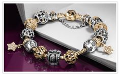 Wow her with silver and gold this holiday!  PandoraMOA.com
