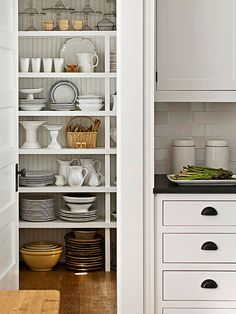 Pantries aren't only meant for storing food. Arrange your china and tableware in an organized, presentable fashion on the shelves of your pantry. Neatly stack plates and bowls, and carefully arrange glasses to ensure that your china is ready for the eyes of any dinner guest.