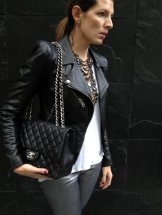 I'm feelin' the biker jacket.. I would wear this with some combat boots.. Chanel combat boots and that bag looks good too.. Maybe smaller.. Heh