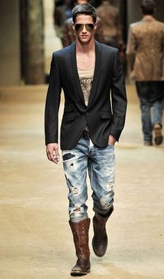 Love the distressed jeans.  Dolce & Gabana blazer.