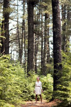 Maine fashion, white dress, belt, forest, tall trees
