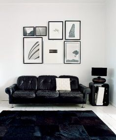 OOH sweet juxtaposition of these monochromatic framed pictures in this #black and white space.